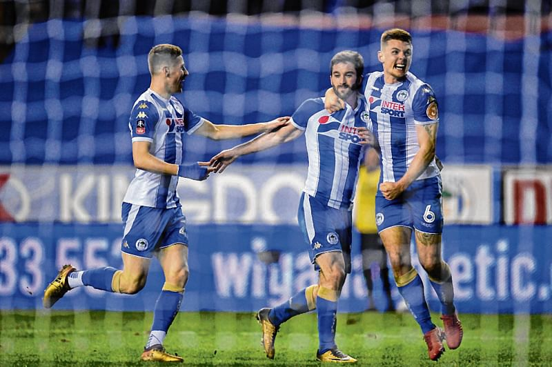 Third-tier Wigan stuns Man City in FA Cup