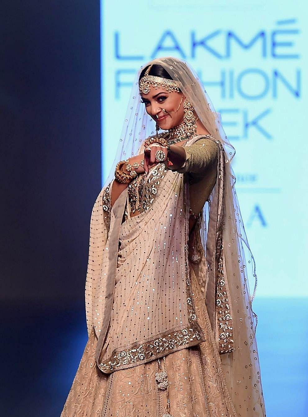 Mumbai: Bollywood actor Sushmita Sen walks the ramp displaying the collection of designers Muzaffar and Meera Ali at Lakme Fashion Week Summer Resort 2018 Mumbai, on Saturday. PTI Photo by Mitesh Bhuvad (PTI2_3_2018_000162B)