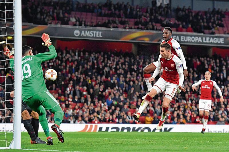 Arsenal, Atletico through