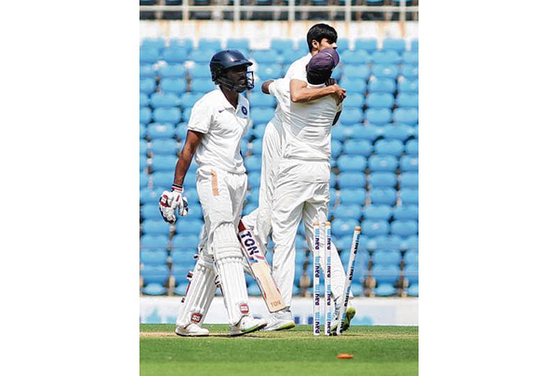Nagpur: Vidarbha bowler RN Gurbani celebrates with team mate after dismissing KS Bharat, batsman of Rest of India  during ZR Irani Cricket Cup match at VCA stadium in Nagpur on Saturday. PTI Photo (PTI3_17_2018_000077B)