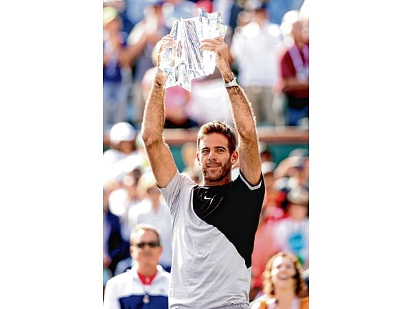 INDIAN WELLS, CA - MARCH 18: Juan Martin Del Potro of Argentina celebrates with the winner's trophy after defeating Roger Federer of Switzerland during the men's final on Day 14 of the BNP Paribas Open at the Indian Wells Tennis Garden on March 18, 2018 in Indian Wells, California.   Matthew Stockman/Getty Images/AFP == FOR NEWSPAPERS, INTERNET, TELCOS & TELEVISION USE ONLY ==