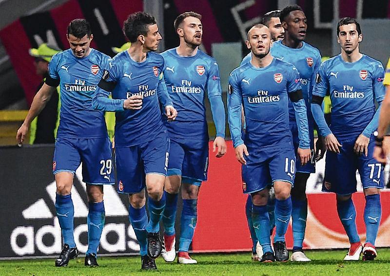 Arsenal guns down Milan