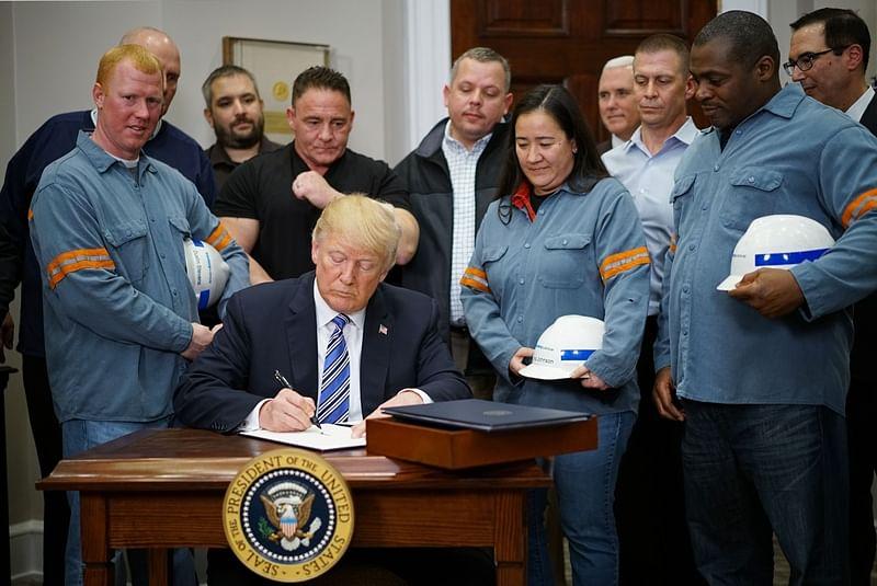 US President Donald Trump signs order on imported steel, aluminium tariffs