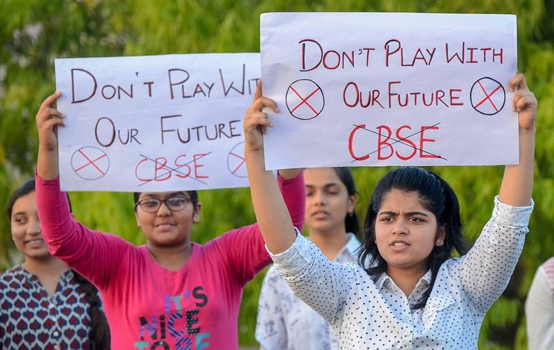 Jabalpur: Central Board of Secondary Education (CBSE) students display placards during a protest over the alleged paper leak, in Jabalpur on Friday. PTI Photo(PTI3_30_2018_000133B)