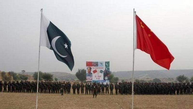 Pakistan and China's national flags fly in the foreground