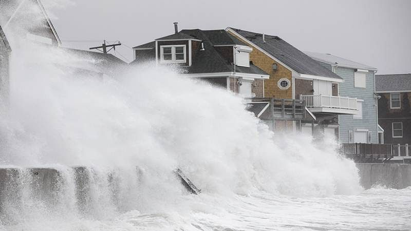 SCITUATE, MA - MARCH 02: Waves crash over houses on Turner Rd. as a large coastal storm affects the area on March 2, 2018 in Scituate, Massachusetts. A powerful nor'easter is bringing snow, rain and high wind to much of the Northeast.   Scott Eisen/Getty Images/AFP == FOR NEWSPAPERS, INTERNET, TELCOS & TELEVISION USE ONLY ==