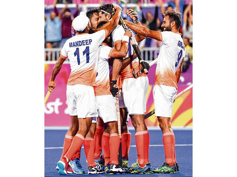 Indian men stun England, top Pool B