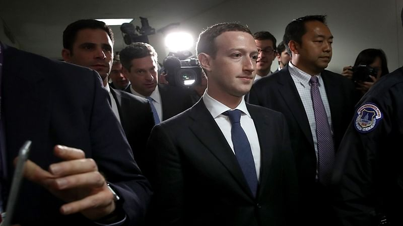 Facebook CEO Mark Zuckerberg (C) leaves the office of Sen. Dianne Feinstein (D-CA) after meeting with Feinstein on Capitol Hill on April 9, 2018