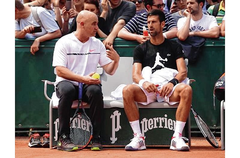 Djokovic splits from Agassi and Stepanek