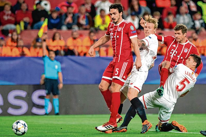 Thiago grabs winner as Bayern comes back to beat Sevilla 2-1