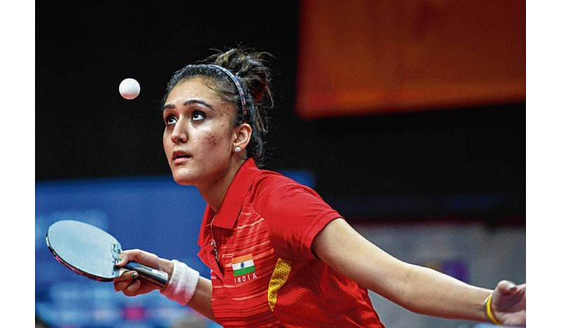 India's Manika Batra serves during the women's singles semi-final table tennis match against Singapore's Feng Tianwei at the 2018 Gold Coast Commonwealth Games at the Oxenford Studios venue in Gold Coast on April 14, 2018. / AFP PHOTO / YE AUNG THU