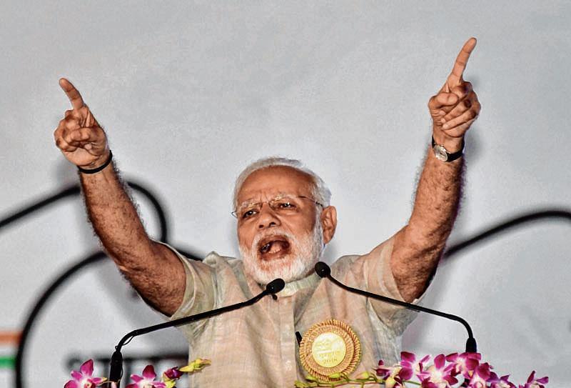 Modi blasts Oppn for 'dividing' the country