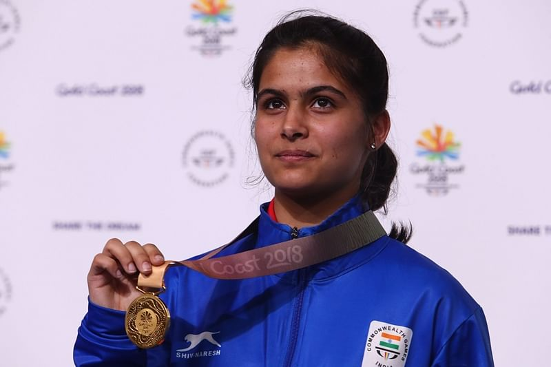 India's gold medallist Manu Bhaker poses with her medal after winning the women's 10m air pistol competition at the 2018 Gold Coast Commonwealth Games at the Belmont Shooting Complex in Brisbane on April 8, 2018.