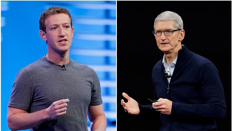 Apple CEO Tim Cook (R) and (L) Facebook CEO Mark Zuckerberg
