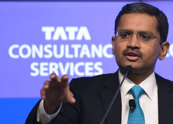 India's Tata Consultancy Services (TCS) CEO and Managing Director Rajesh Gopinathan speaks during a news conference after the announcement of the financial results of the company in Mumbai on April 19, 2018. / AFP PHOTO / PUNIT PARANJPE