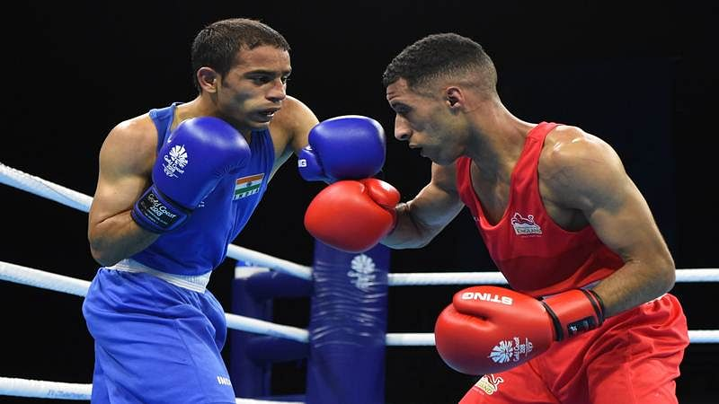 England's Galal Yafai (R) fights with India's Amit in their men's 46-49kg final boxing match during the 2018 Gold Coast Commonwealth Games at the Oxenford Studios venue on the Gold Coast on April 14, 2018. / AFP PHOTO / Anthony WALLACE
