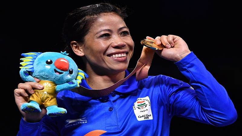 India's MC Mery Kom poses with her gold medal after beating Northern Ireland's Kristina O'Hara in their women's 45-48kg final boxing match during the 2018 Gold Coast Commonwealth Games at the Oxenford Studios venue on the Gold Coast on April 14, 2018. / AFP PHOTO / Anthony WALLACE