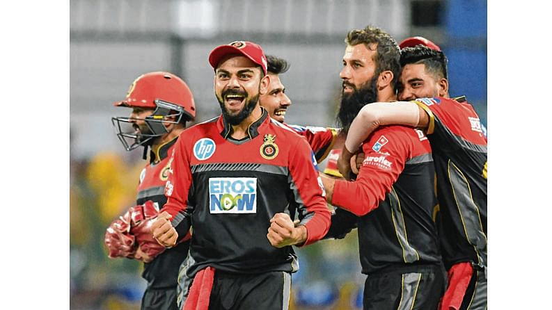 Royal Challengers Bangalore captain Virat Kohli (2L) celebrates with teammates