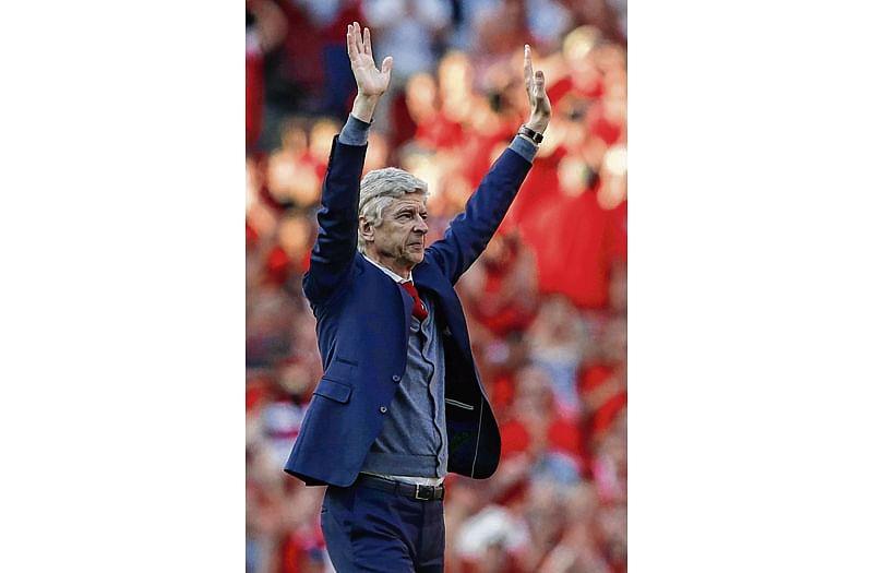 Wenger, still in 'shock', sets deadline for future plans