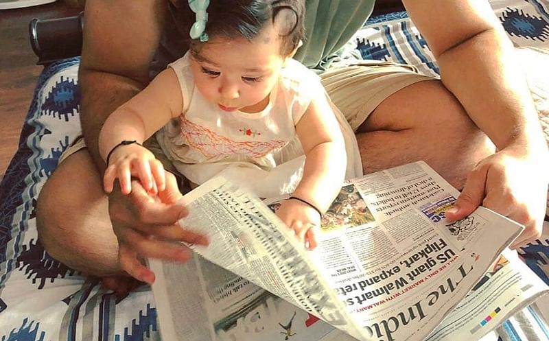 This picture of Kunal Khemu's daughter Inaaya 'reading' a newspaper is the cutest thing you'll see today