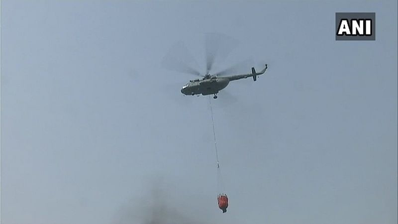 Indian Air Force deploys helicopter to douse Delhi's Malviya Nagar fire