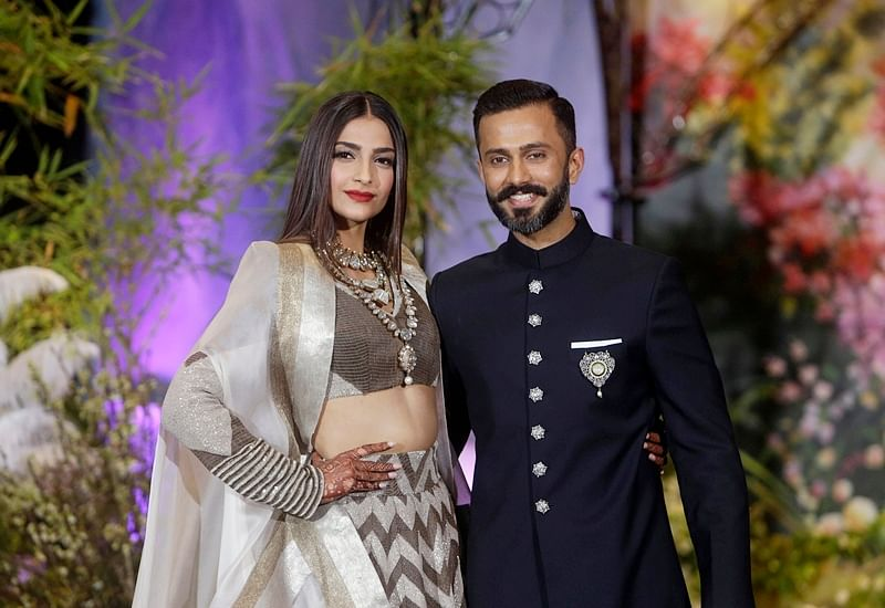 Sonam Kapoor-Anand Ahuja Reception: Newly-wed couple Sonam and Anand looking gorgeous in their reception outfits; check out