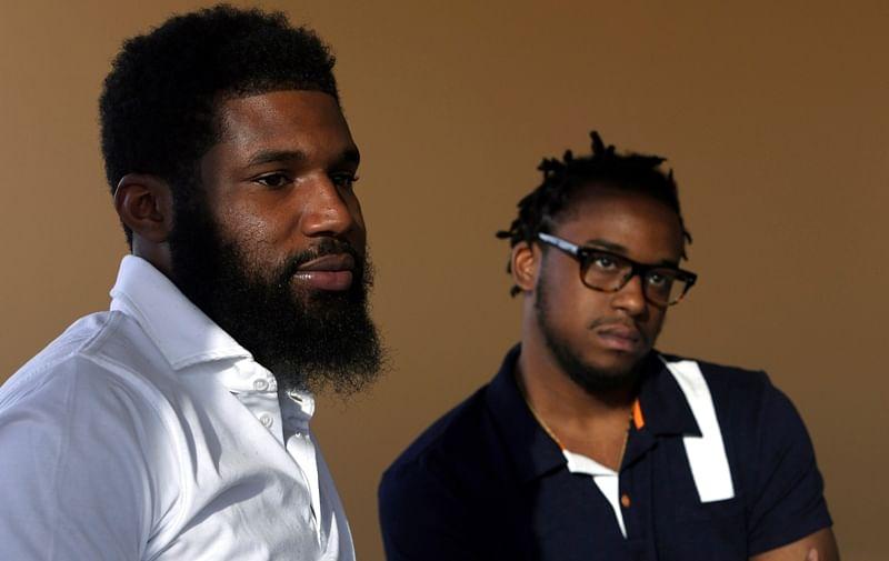 Two black men arrested at Starbucks reach settle with Philadelphia for $1