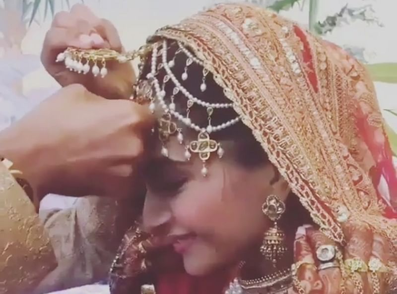 Video of Sonam Kapoor kissing Anand Ahuja after he applies sindoor goes viral