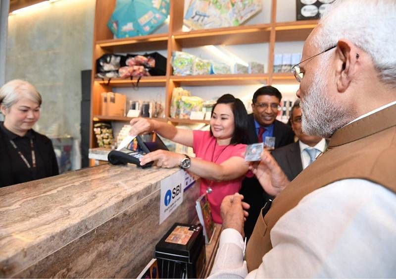 Modi in Singapore: Prime Minister Narendra Modi purchases Madhubani painting using a RuPay card