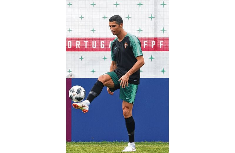 Portugal's forward Cristiano Ronaldo attends a training session at the team's base in Kratovo, outside Moscow, on June 19, 2018, on the eve of the Russia 2018 World Cup Group B football match between Portugal and Morocco. / AFP PHOTO / Francisco LEONG