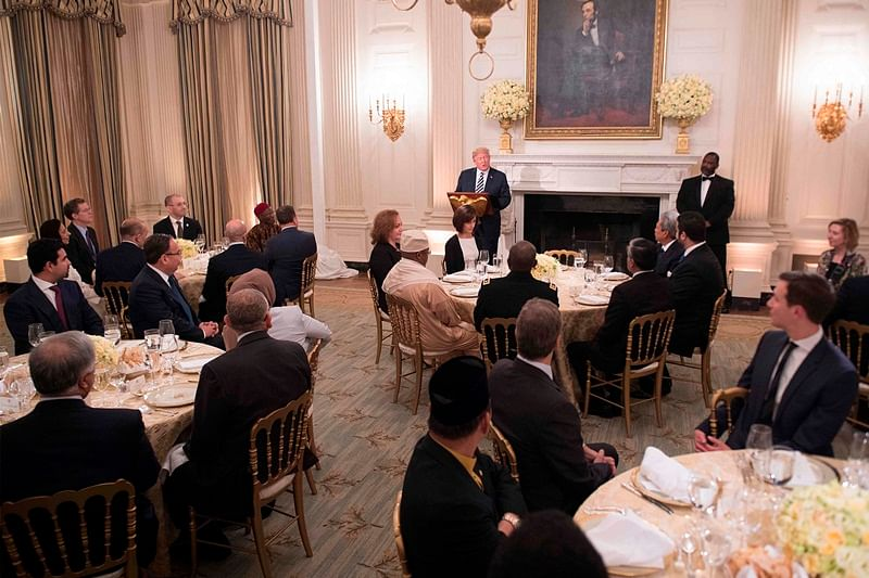 US President Donald Trump speaks during an iftar dinner hosted at the White House in Washington, DC, on June 6, 2018. Donald Trump hosts his first iftar dinner as president, marking the traditional Ramadan fast-breaking meal with Muslim invitees at the White House. / AFP PHOTO / JIM WATSON