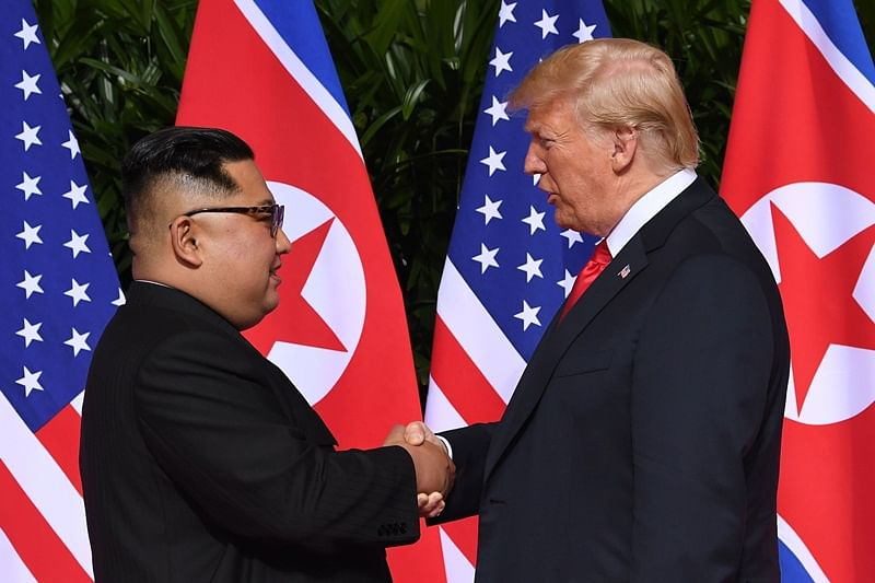 Donald Trump and Kim Jong Un have become on June 12 the first sitting US and North Korean leaders to meet, shake hands and negotiate to end a decades-old nuclear stand-off. / AFP PHOTO / SAUL LOEB
