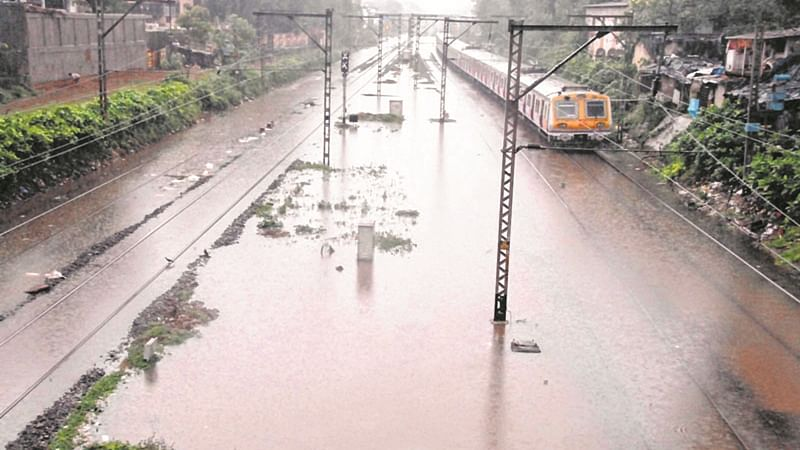 Mumbai: As heavy rains lashed on Monday, local train services disrupted