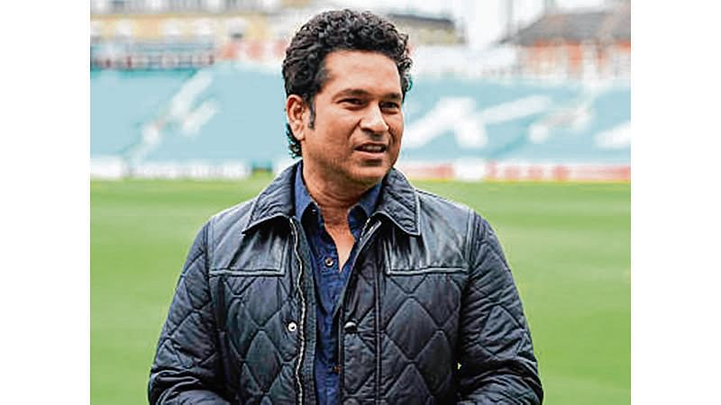 """Indian cricket legend Sachin Teldulkar poses for a photograph during a photocall at the Oval cricket ground in south London on May 6, 2017, promoting the upcoming release of his film, """"Sachin: A Billion Dreams"""".    / AFP PHOTO / Niklas HALLE'N"""