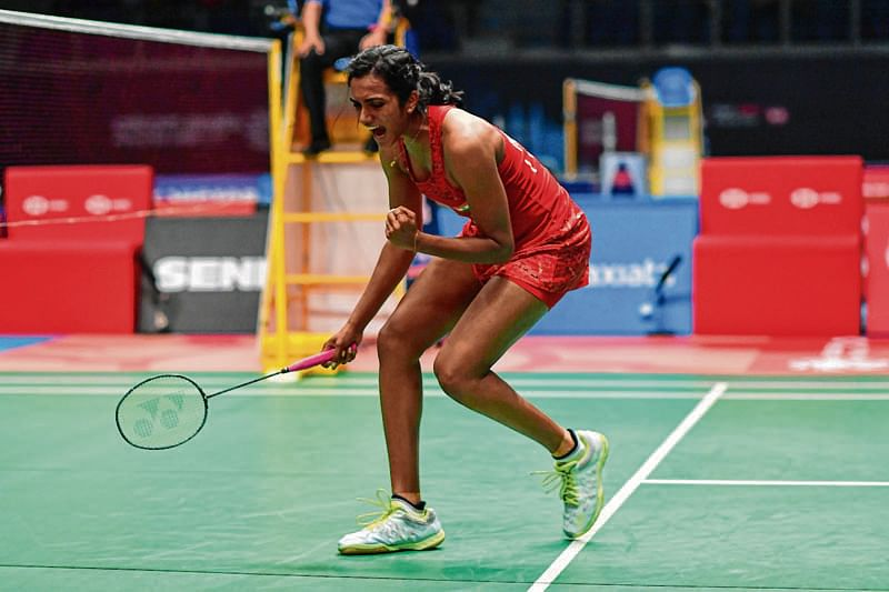 Pusarla Venkata Sindhu of India reacts after winning a point against Carolina Marin of Spain during their women's singles quarterfinal match at the Malaysia Open Badminton tournament in Kuala Lumpur on June 29, 2018. / AFP PHOTO / Mohd RASFAN