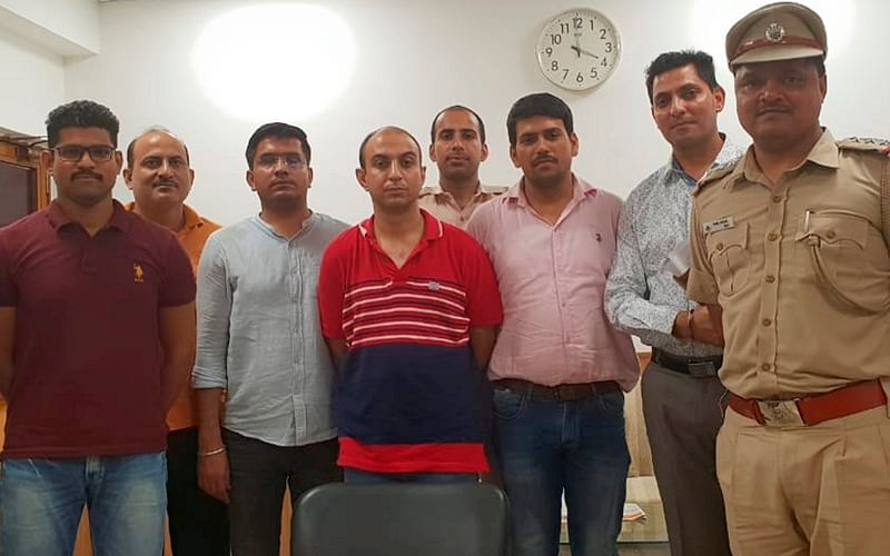 Army Major, Nikhil Handa (C) (in red t-shirt), arrested, in relation to the murder of another Major's wife, from Uttar Pradesh's Meerut. PTI Photo