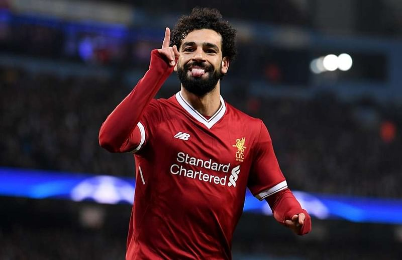 UEFA Champions League: Mohamed Salahreaches 50 goals as Liverpool ease past Red StarBelgrade4-0