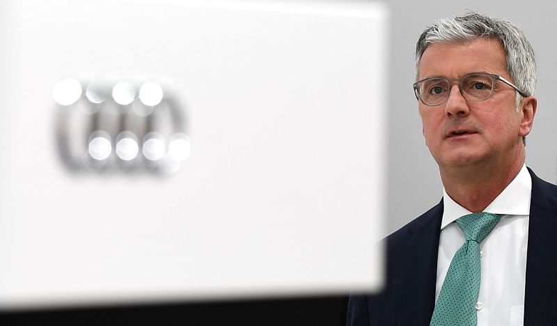 In this file photo Rupert Stadler, CEO of German car maker Audi, waits prior to the Audi AG general meeting in Ingolstadt, southern Germany. / AFP PHOTO / CHRISTOF STACHE