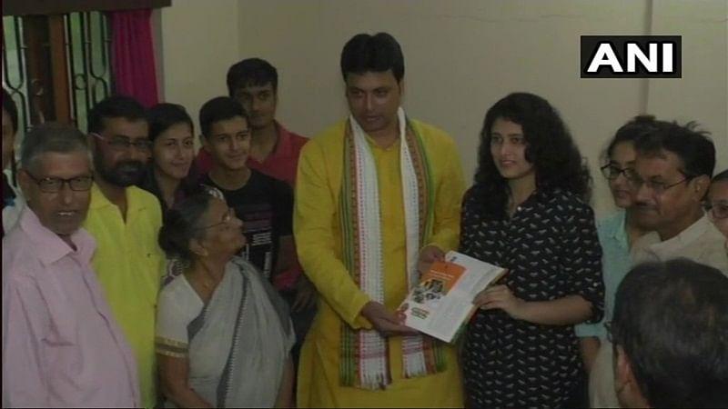 Tripura CM Biplab Kumar Deb meets kickboxer Nishtha Chakraborty as part of BJP's 'Sampark for Samarthan' campaign