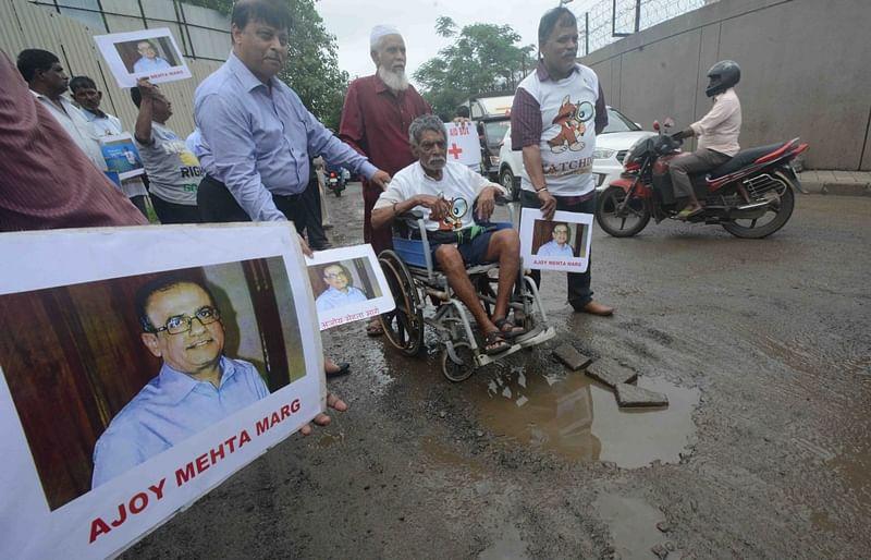 Mumbai: After BMC fails to responsibility, NGO in protest names pothole-ridden road as 'Ajoy Mehta Marg'