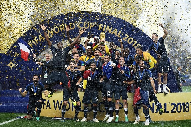 France's players celebrate as they hold their World Cup trophy during the trophy ceremony at the end of the Russia 2018 World Cup final football match between France and Croatia at the Luzhniki Stadium in Moscow on July 15, 2018. / AFP PHOTO / FRANCK FIFE / RESTRICTED TO EDITORIAL USE - NO MOBILE PUSH ALERTS/DOWNLOADS