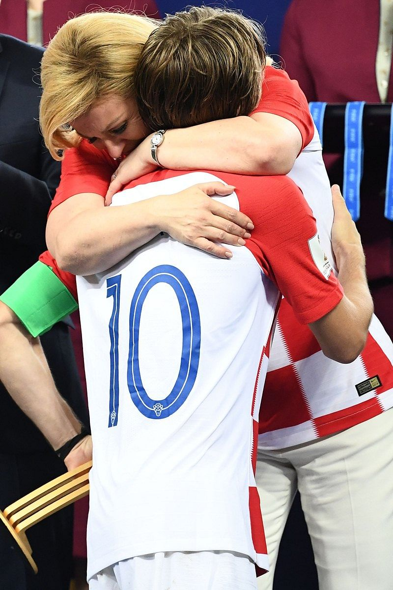 Croatian President Kolinda Grabar-Kitarovic (L) greets Croatia's midfielder Luka Modric during the trophy ceremony at the end of the Russia 2018 World Cup final football match between France and Croatia at the Luzhniki Stadium in Moscow on July 15, 2018.