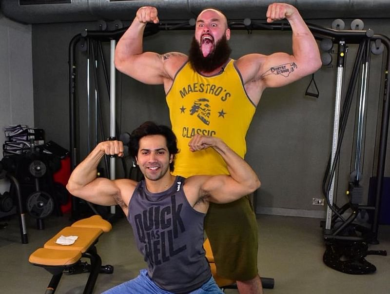 See pic: Varun Dhawan flesxes muscle with WWE superstar Braun Strowman