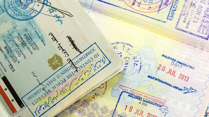 passports with syria, maldives and thailand visa stamps