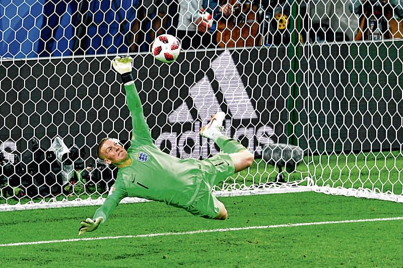 England's goalkeeper Jordan Pickford saves a penalty kicked by Colombia's forward Carlos Bacca during the penalty shootouts during the Russia 2018 World Cup round of 16 football match between Colombia and England at the Spartak Stadium in Moscow on July 3, 2018. / AFP PHOTO / Mladen ANTONOV / RESTRICTED TO EDITORIAL USE - NO MOBILE PUSH ALERTS/DOWNLOADS
