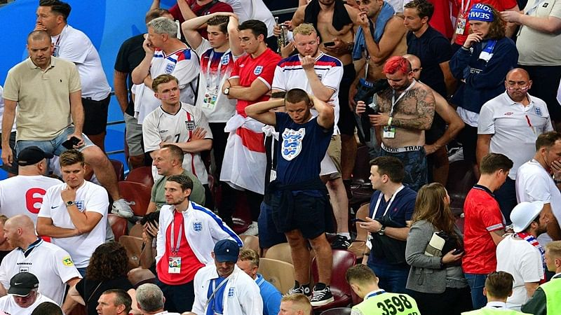 England supporters react after their team lost the  Russia 2018 World Cup semi-final football match between Croatia and England at the Luzhniki Stadium in Moscow on July 11, 2018.  AFP PHOTO / Mladen ANTONOV