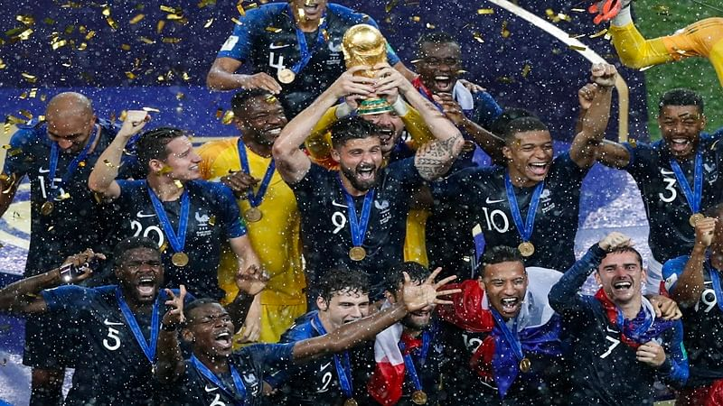Moscow :France's Olivier Giroud holds up the trophy as he celebrates with teammates at the end of the final match between France and Croatia at the 2018 soccer World Cup in the Luzhniki Stadium in Moscow, Russia, Sunday, July 15, 2018. AP/PTI Photo(AP7_16_2018_000004B)