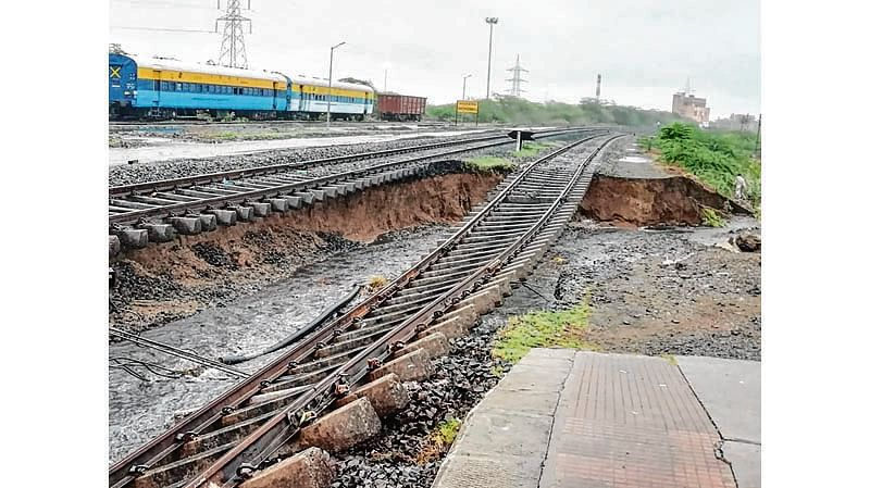 """This handout photo taken and released by PRO Western Railway on July 17, 2018 shows damaged railway tracks following flooding after heavy rains at Kanalus railway station near Jamnagar, some 340km from Ahmedabad in India's western Gujarat state. / AFP PHOTO / PRO WESTERN RAILWAY / Handout / -----EDITORS NOTE --- RESTRICTED TO EDITORIAL USE - MANDATORY CREDIT """"AFP PHOTO / PRO WESTERN RAILWAY """" - NO MARKETING - NO ADVERTISING CAMPAIGNS - DISTRIBUTED AS A SERVICE TO CLIENTS"""