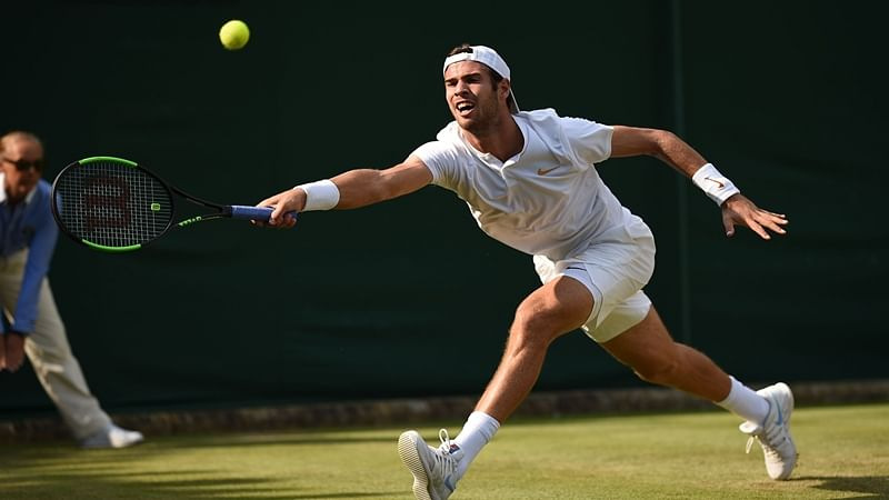 Russia's Karen Khachanov returns to Cyprus's Marcos Baghdatis in their men's singles second round match on the fourth day of the 2018 Wimbledon Championships at The All England Lawn Tennis Club in Wimbledon, southwest London, on July 5, 2018. / AFP PHOTO / Oli SCARFF / RESTRICTED TO EDITORIAL USE
