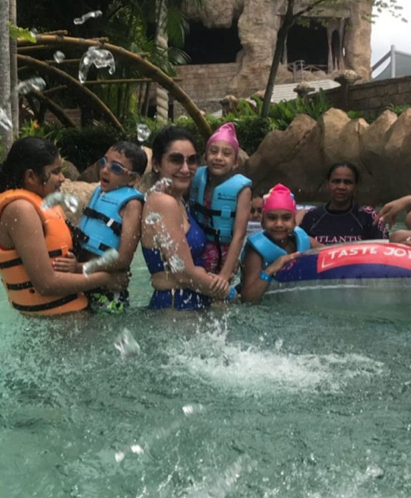 Maanayata Dutt is chilling and relaxing in a pool with kids Iqra and Shahraan